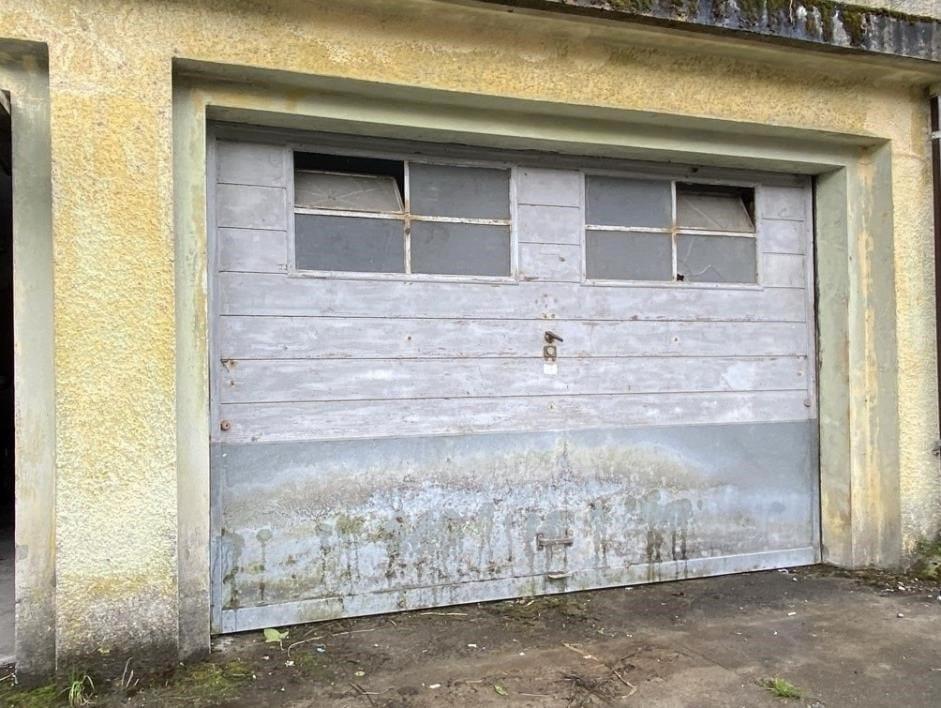 Garagentor Sanierung Schwingtor